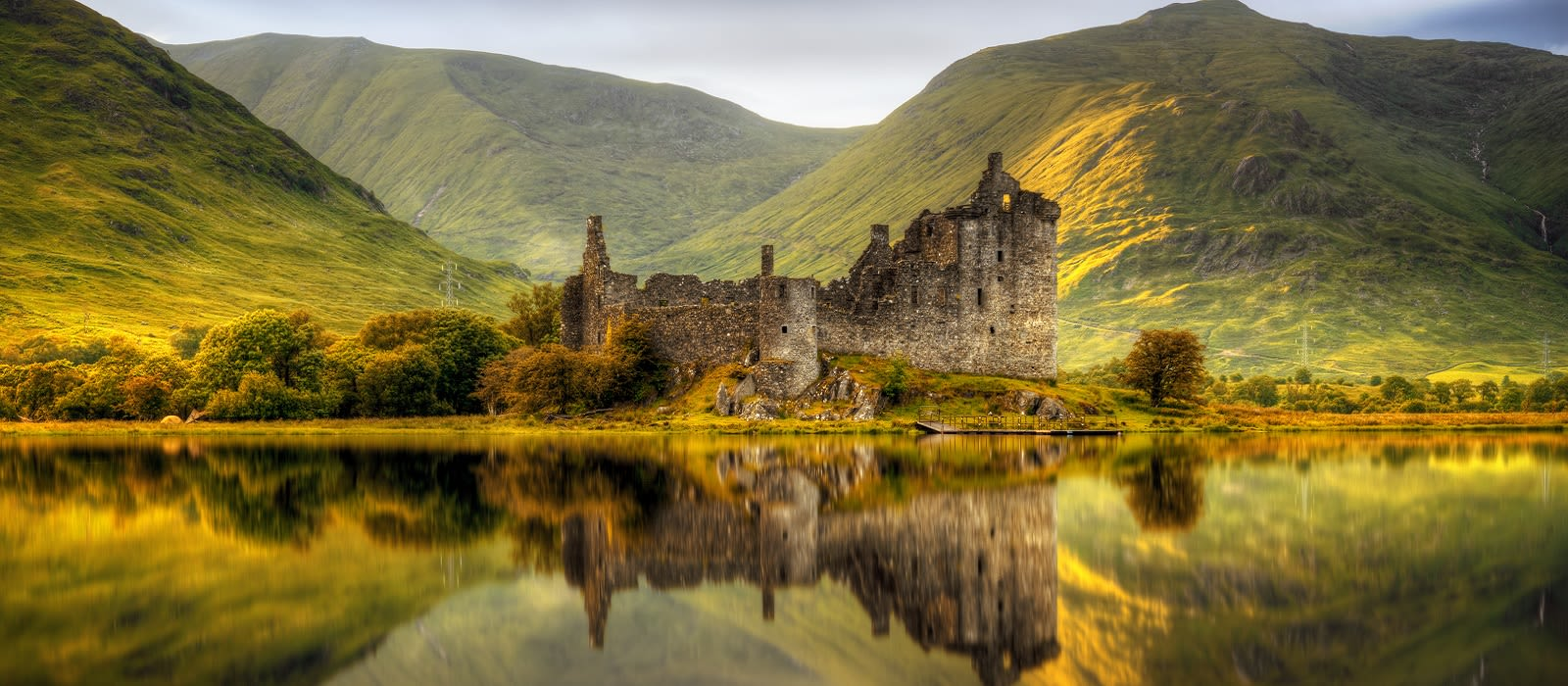 Enchanting Travels UK & Ireland Tours Kilchurn Castle reflections in Loch Awe at sunset, Scotland