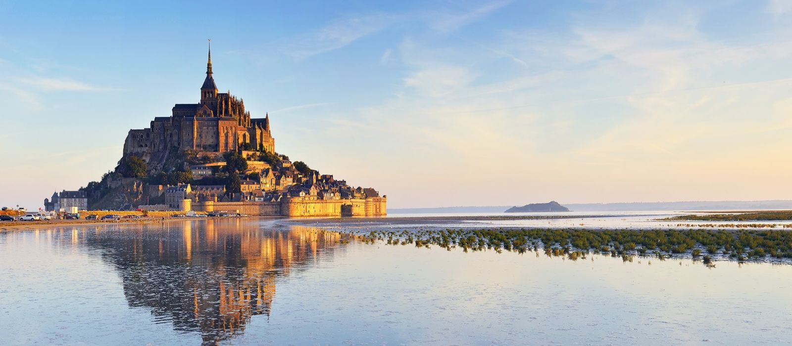 Beautiful panoramic view of famous Le Mont Saint-Michel tidal island, Normandy, northern France, Europe