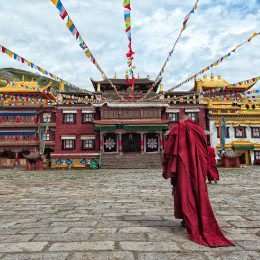 Enchanting Travels Tibet Tours lama going towards the temple Tibet