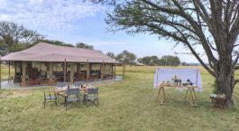 Outdoor dining at Lounge area at Kimondo Migration Camp (North) in Serengeti (Northern), Tanzania