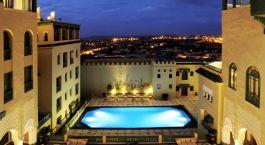 Enchanting-Travels-Morocco-Tours-Fes-Hotels-Palais-Faraj-Suites-SpaPool-Patio-night-1.jpg