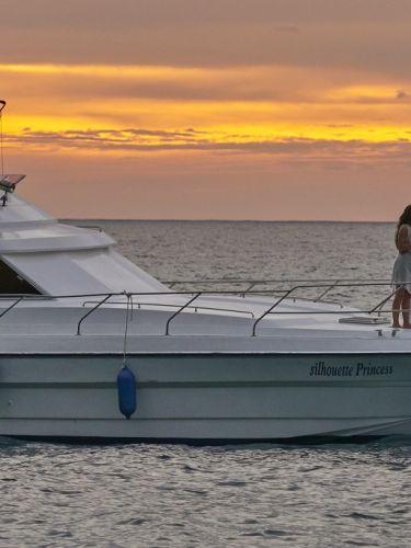 Couples enjoying in cruise during sunset