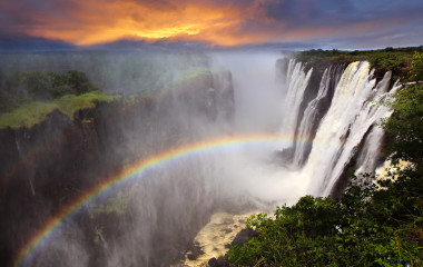 Victoria Falls sunset with rainbow