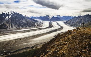 Hiker photographing beautiful Kaskawulsh Glacier in Kluane National Park, Yukon, Canada