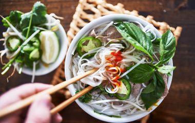 vietnamese pho with spicy sriracha sauce shot top down