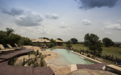 Enchanting Travels - Tanzania Tours - Serengeti (Northern) Hotel - Sayari Camp - Pool area view from rock