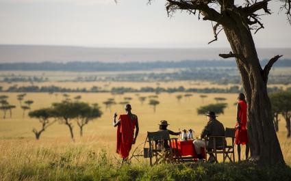 Menschen frühstücken im Busch der Masai Mara, Afrika