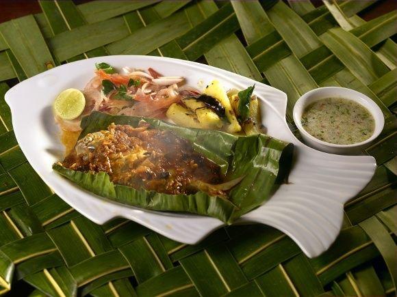 Südindien: Fisch in Bananenblättern serviert