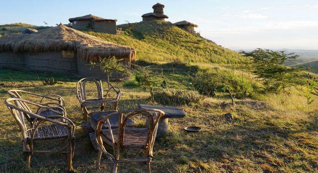 External view of accommodations at Africa Amini Maasai Lodge in Masai Mara, Kenya