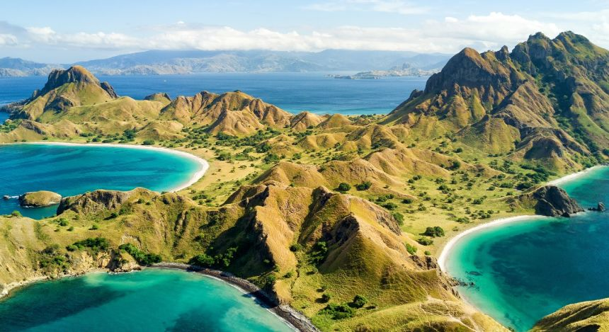 Enchanting Travels Indoensia Tours Aerial view of Pulau Padar island in between Komodo and Rinca Islands near Labuan Bajo