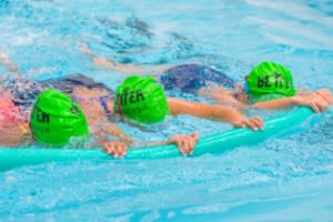 Children swimming together