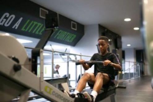 Boy on gym equipment