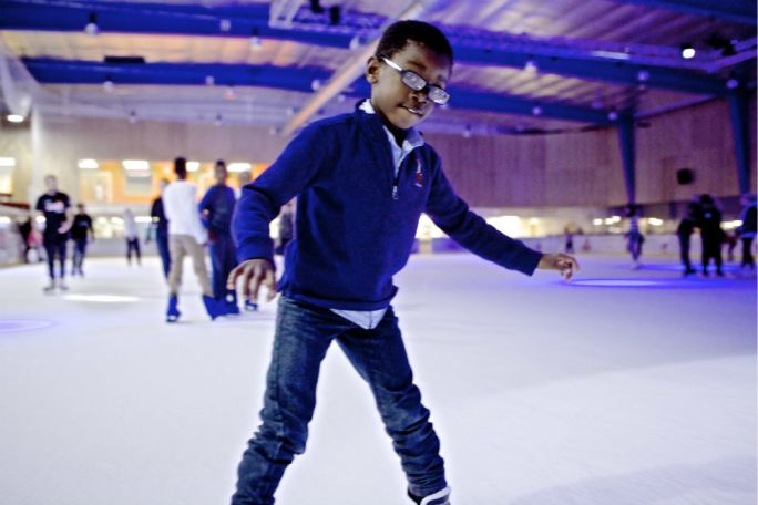 Child at an ice skating birthday party