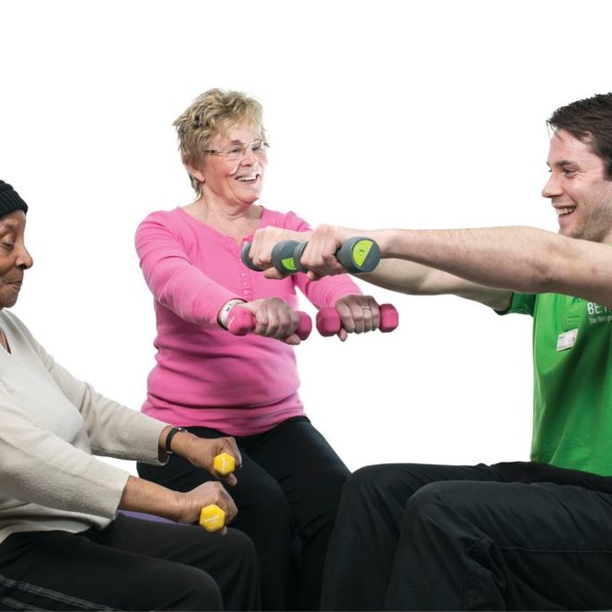 News_Story_Image_Crop-Adult_male_and_female_on_fitball_with_dumbbells.jpg