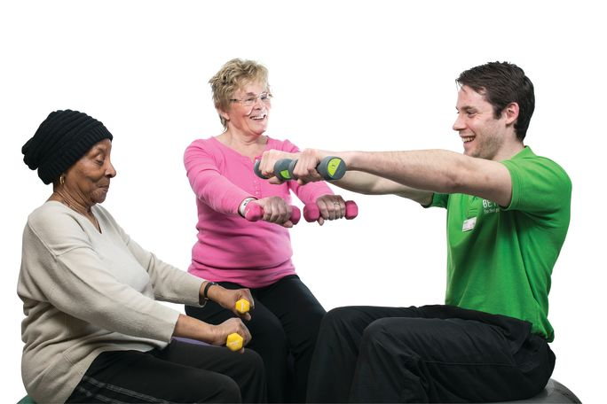 Adult_male_and_female_on_fitball_with_dumbbells.jpg