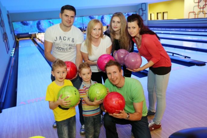 Family group doing tenpin bowling