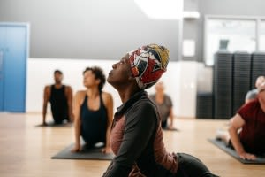 Woman doing yoga at Better