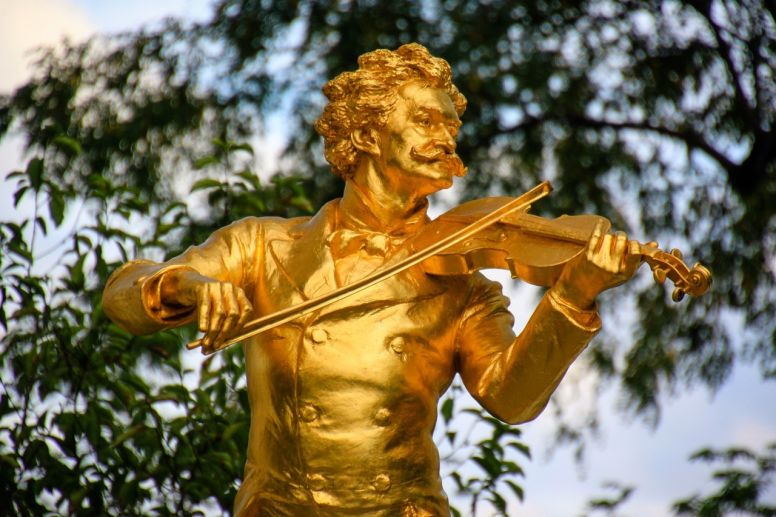 Golden Statue of Mozart Playing Violin