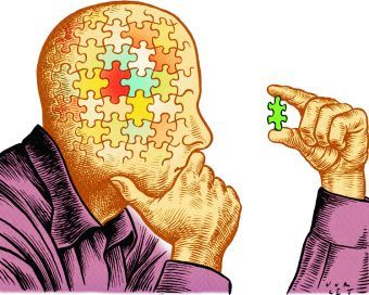 A man with puzzle pieces for a head, looking at a puzzle piece critically.