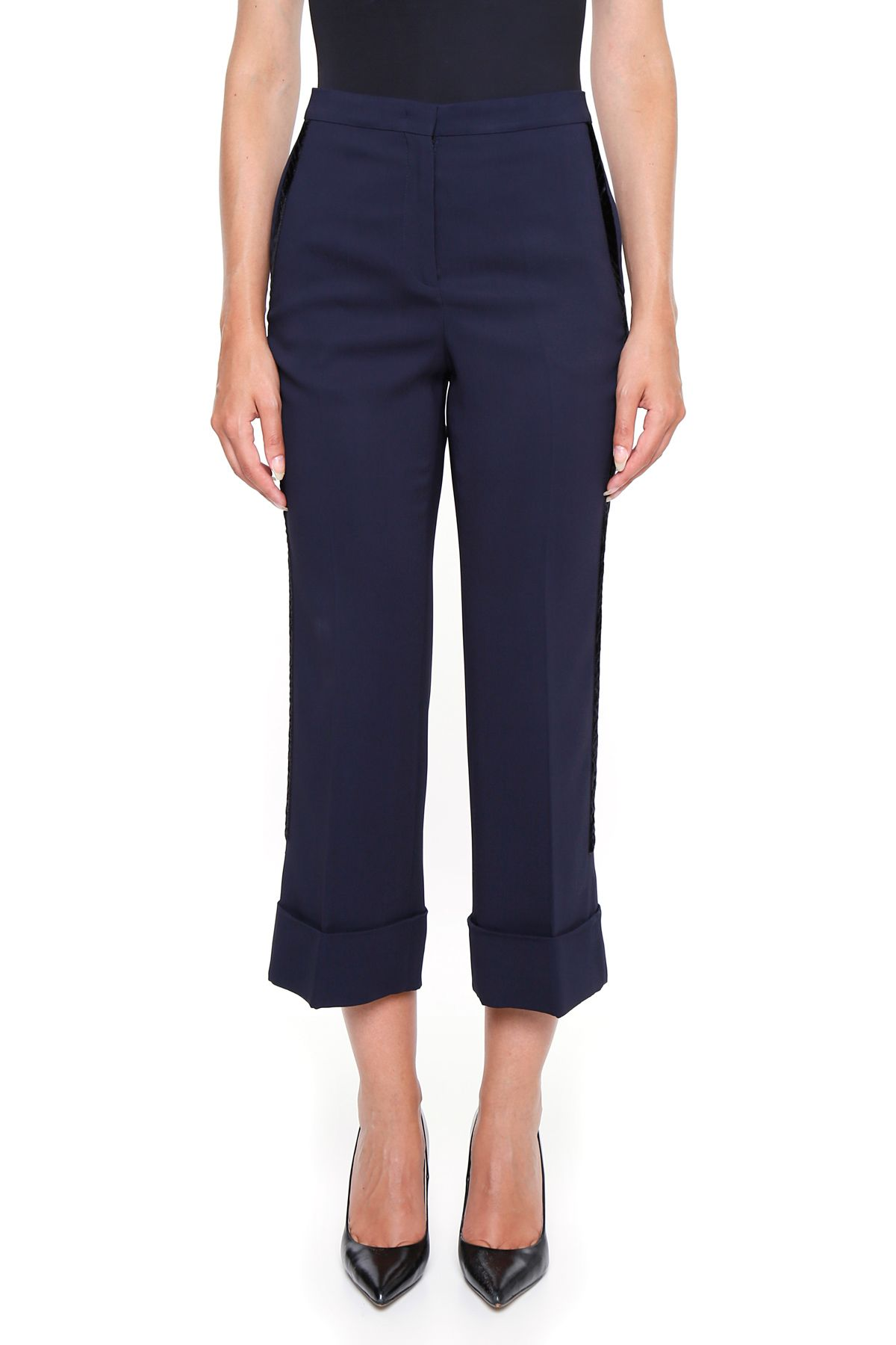 Soft and comfy wide-leg cropped pant with tie-front elastic waist and pockets. Fully lined. Imported.
