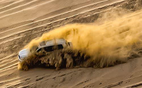 SUV on sand dune