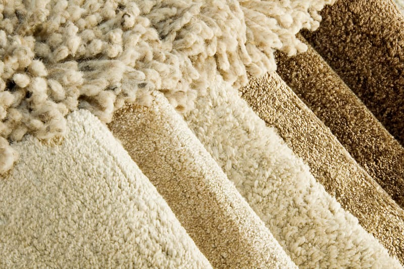 new carpet rolls in different beige colors