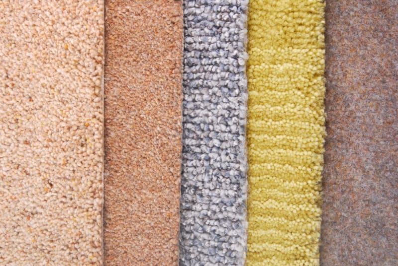 samples of carpet with different textures and colors