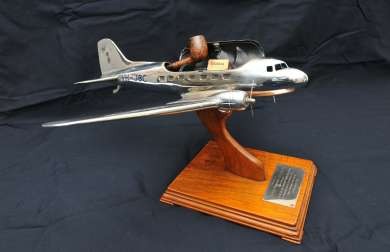 DC3 model airplane presented to Prime Minister Ben Chifley at the service to open the Bathurst airstrip as a civilian aerodrome with scheduled passenger flights.