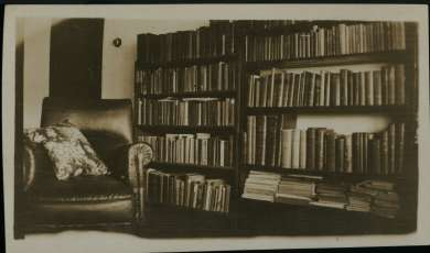 Armchair and books in the lounge room at the Curtin Family Home, Cottesloe