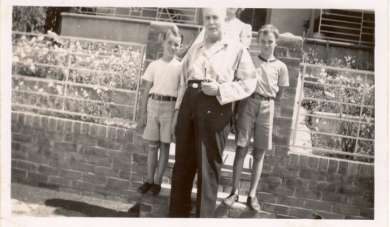 Ben Chifley with children at the front gate of his home at 10 Busby St, Bathurst
