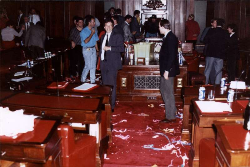 Senator Robert Hill (facing camera) and colleagues party in the Senate chamber after the last sitting. Photographer – Trevor Fowler, Hansard Reporter, MoAD Collection.
