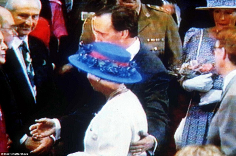 Keating's hand on the Queen's back, seen here on a TV screen, made headlines around the world. It wouldn't be the last time Keating's attitude to the monarchy would irk the British press. Rex Shutterstock.