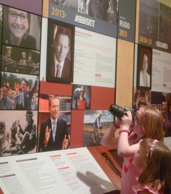 Sophie Deane and her sister, in front of Sophie's photo of Julia Gillard. Museum of Australian Democracy.