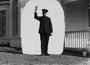 Traffic Signals. Demonstration of Traffic signals by policeman. NationalArchivesofAustralia:A3560,4134.