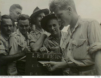 Nineteen-year-old Leading Aircraftman Peter Boland, stationed at Nadzab, New Guinea, votes for the first time in the 1944 referendum. Image: Australian War Memorial 017496