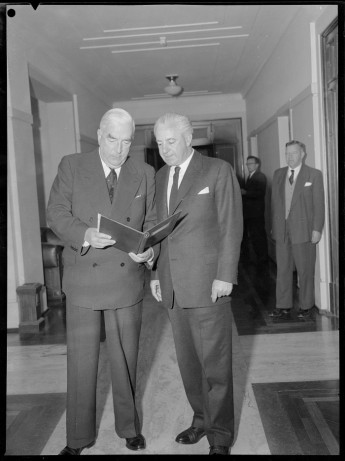 When Robert Menzies retired he was succeeded by his Treasurer, Harold Holt. The two men are seen here together at Parliament House. Credit: National Library of Australia.