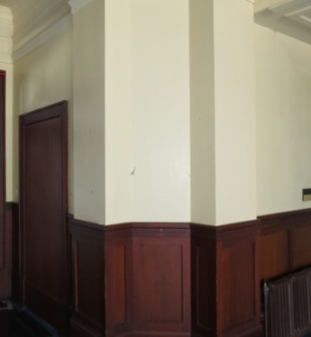 A corner of the Members' Dining Room. The plain cream walls hide a surprising paint finish. Museum of Australian Democracy Collection.