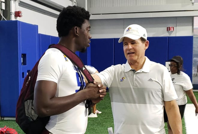 Jones talked with Les Miles after the camp on Friday night