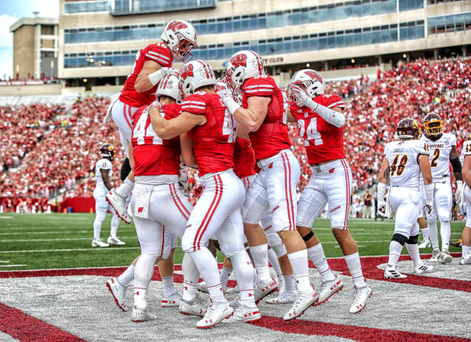 The Wisconsin Badgers celebrating after a touchdown against Central Michigan