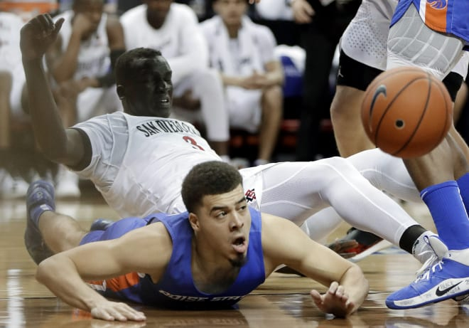 Boise State's Alex Hobbs (34) and San Diego State's Aguek Arop (3) go for a loose ball during the second half of an NCAA college basketball game in the Mountain West Conference men's tournament Friday, March 6, 2020, in Las Vegas.