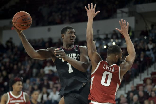Perry's double-double lifts Missississippi St. past Arkansas