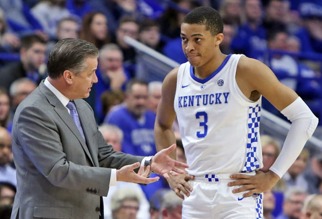 Kentucky head coach John Calipari worked with freshman forward Keldon Johnson during the Florida game at Rupp Arena.