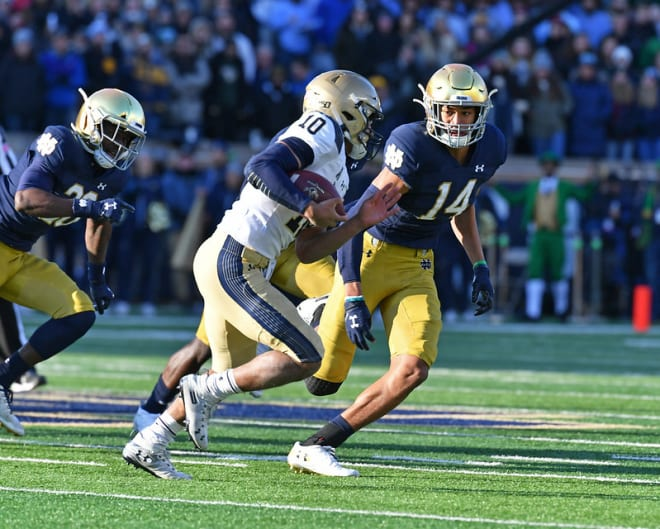 Freshman safety Kyle Hamilton and the Irish defense kept quarterback Malcolm Perry and the Navy offense at bay while recovering four fumbles. This play by Hamilton was a one-yard loss by Perry on fourth-and-one.