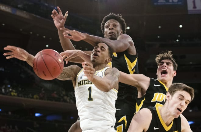 Game 4: Michigan Wolverines outlast Iowa, 77-71, in overtime