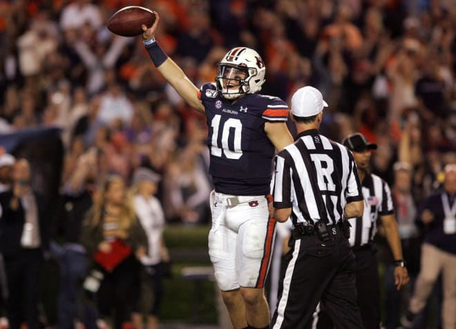 Nix (10) celebrates with the game ball after the final play of the 2019 Iron Bowl.