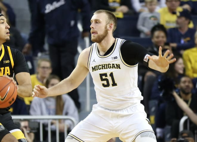 Michigan Wolverines basketball big man Austin Davis has been a productive offensive player the post this year.