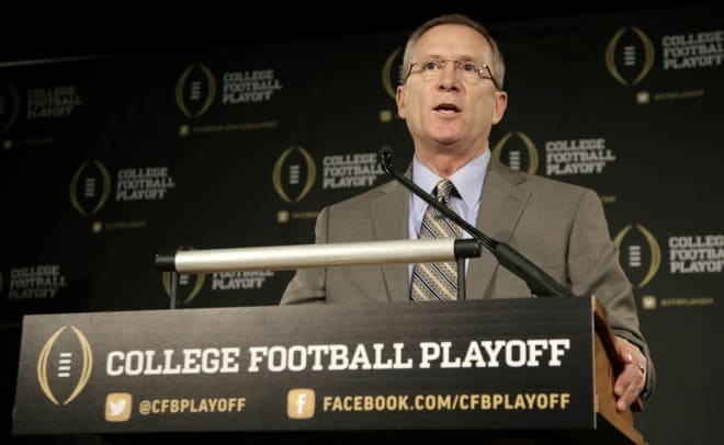 Kansas hires former CFP chair Long as AD