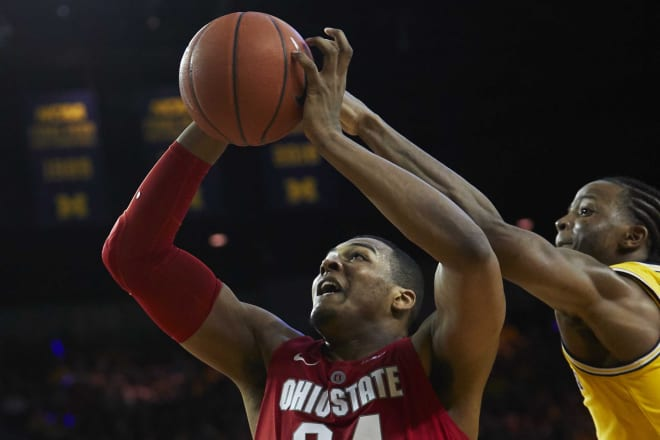 Junior point guard Zavier Simpson says not so fast on a shot attempt by OSU's Kaleb Wesson.