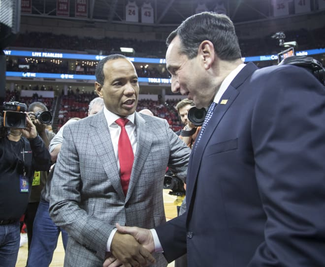 Head coaches Kevin Keatts (left) and Mike Krzyzewski shake hands before the game.