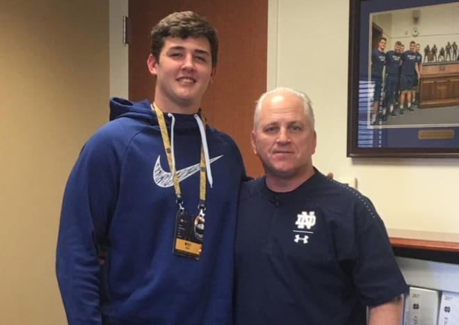 Notre Dame OL target Wyatt Milum with OL coach Jeff Quinn during a spring visit